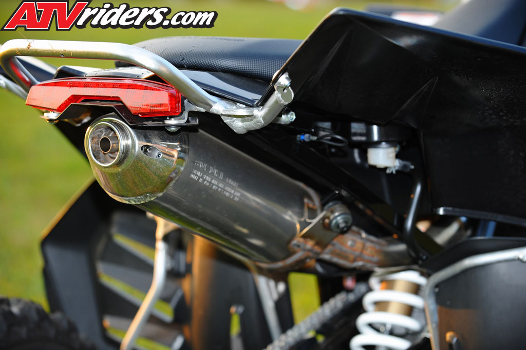 The exhaust on the Suzuki LTR450 is mounted in the center unlike other sport